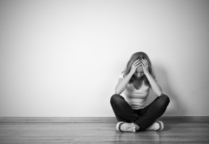 bigstock-Girl-Sits-In-A-Depression-On-T-52227706-300x207[2]